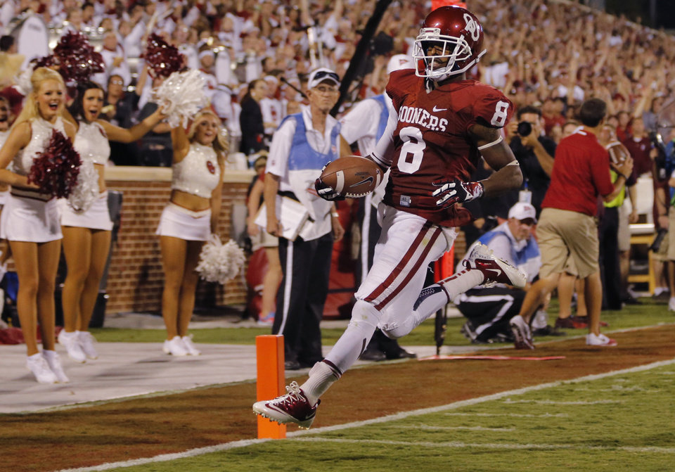 Oklahoma\'s Jalen Saunders (8) scores a touchdown during the college football game between the University of Oklahoma Sooners (OU) and the University of Louisiana Monroe Warhawks (ULM) at the Gaylord Family Memorial Stadium on Saturday, Aug. 31, 2013 in Norman, Okla. Photo by Chris Landsberger, The Oklahoman