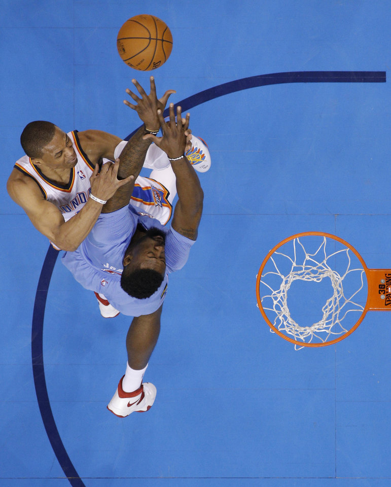 Photo - Oklahoma City 's Russell Westbrook (0) shoots over Los Angeles' DeAndre Jordan (6) during the NBA game between the Oklahoma City Thunder and the Los  Angeles Clippers at the Chesapeake Energy Arena, Sunday, Feb. 23, 2014. Photo by Sarah Phipps, The Oklahoman