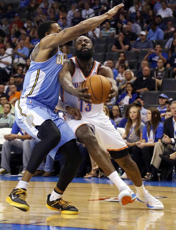 Photo - Oklahoma City's James Harden (13) tries to get by Denver's Andre Iguodala (9) during the NBA preseason basketball game between the Oklahoma City Thunder and the Denver Nuggets at the Chesapeake Energy Arena, Sunday, Oct. 21, 2012. Photo by Sarah Phipps, The Oklahoman