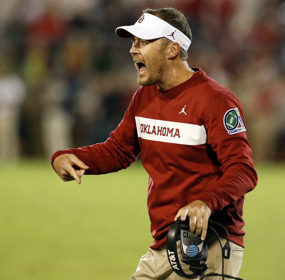 Photo - Lincoln Riley shouts to his team as the game goes into overtime during a college football game in which the University of Oklahoma Sooners (OU) defeated the Army Black Knights 28-21 at Gaylord Family-Oklahoma Memorial Stadium in Norman, Okla., on Saturday, Sept. 22, 2018. Photo by Steve Sisney, The Oklahoman