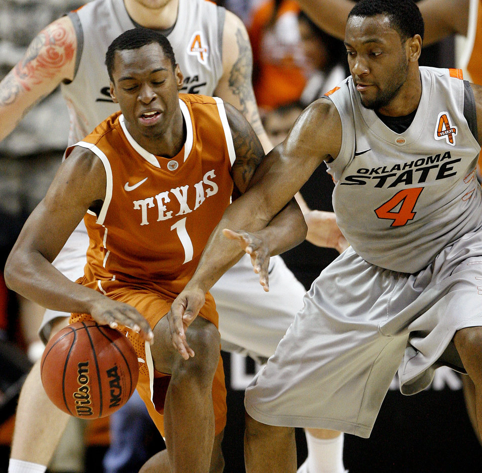 Photo - Texas' Sheldon McClellan (1) and Oklahoma State's Brian Williams (4) go for the ball during an NCAA college basketball game between Oklahoma State University (OSU) and the University of Texas (UT) at Gallagher-Iba Arena in Stillwater, Okla., Saturday, Feb. 18, 2012. Oklahoma State won 90-78. Photo by Bryan Terry, The Oklahoman