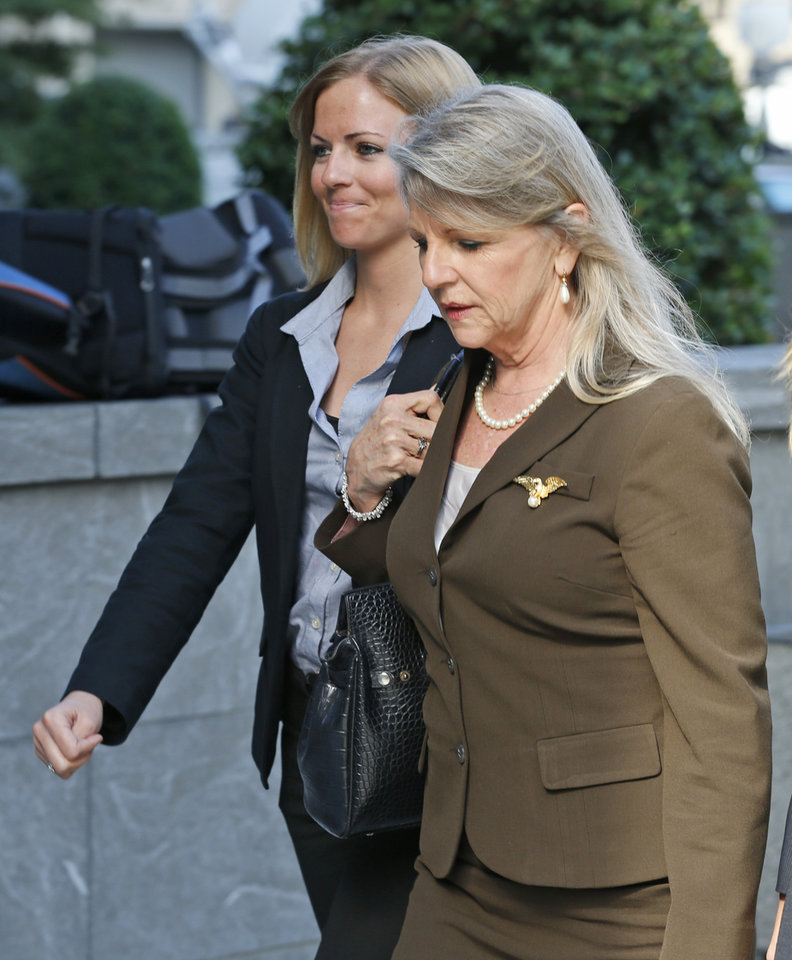 Photo - Former Virginia first lady, Maureen McDonnell, right, arrives at federal court with her daughter, Rachell McDonnell, in Richmond, Va., Wednesday, Aug. 20, 2014. The defense continues to present it's case in the McDonnell corruption trial.  (AP Photo/Steve Helber)