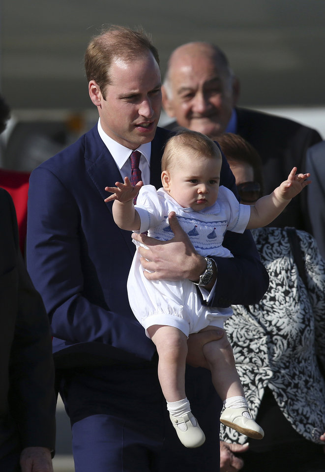 Britain's Prince William holds his son, Prince George, after arriving in Sydney Wednesday, April 16, 2014. Prince William and his wife Kate, Duchess of Cambridge and Prince George, are on a three-week tour of Australia and New Zealand, the first official trip overseas with their son, Prince George. (AP Photo/Rob Griffith)