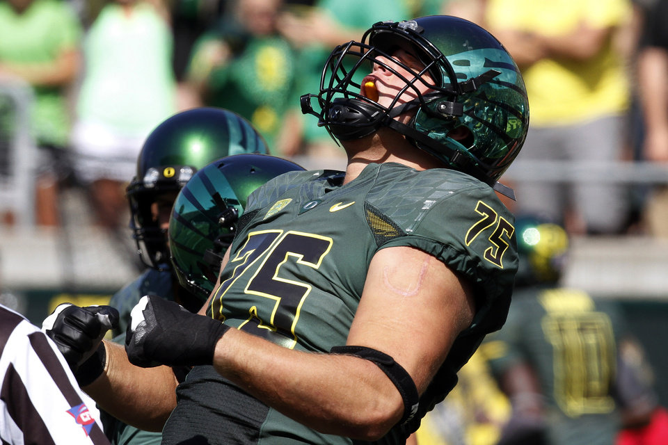 Photo -   Oregon offensive lineman Jake Fisher reacts after recovering an Oregon fumble for a touchdown during the first half of their NCAA college football game against Tennessee Tech in Eugene, Ore., Saturday, Sept. 15, 2012. (AP Photo/Don Ryan)