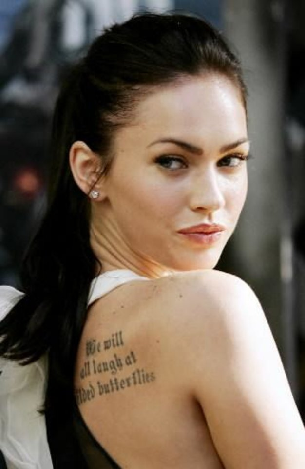 """Photo -  U.S. actress  Megan  Fox looks over her shoulder during a photo call to promote her new movie """"Transformers"""" in Syndey Wednesday, June 13, 2007. (AP Photo/Rick Rycroft)"""