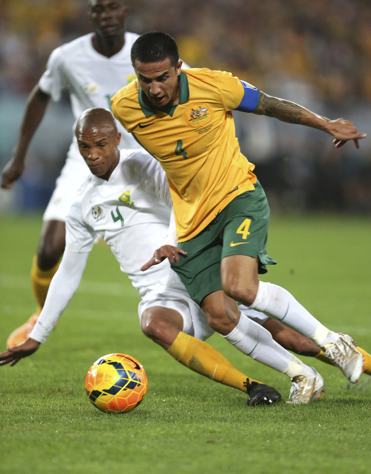 Photo - Australia's Tim Cahill, right, and South Africa's Thabo Benett Nthethe battle for the ball during their Soccer friendly match in Sydney, Australia, Monday, May 26, 2014. (AP Photo/Rob Griffith)