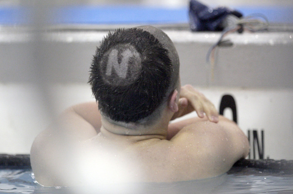 Edmond North's Cole Duncan finishes a race during the state championship swim meet at  Oklahoma City Community College, Friday, Feb. 17, 2012. Photo by Sarah Phipps, The Oklahoman