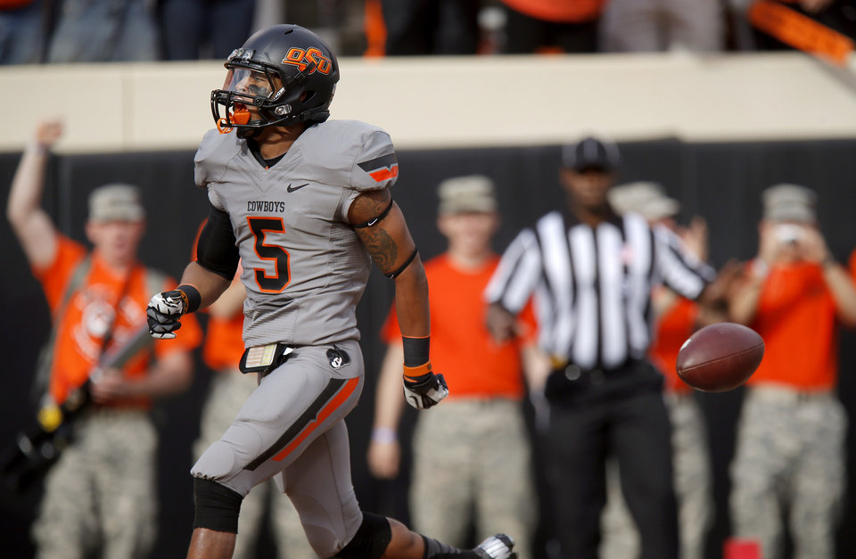 Oklahoma State\'s Josh Stewart (5) scores a touchdown during a college football game between Oklahoma State University (OSU) and the University of West Virginia at Boone Pickens Stadium in Stillwater, Okla., Saturday, Nov. 10, 2012. Photo by Bryan Terry, The Oklahoman
