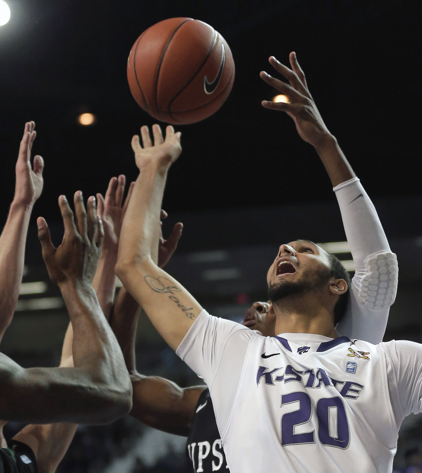 Photo - Kansas State forward Adrian Diaz (20) battles several South Carolina Upstate players for a rebound during the first half of an NCAA college basketball game on Sunday, Dec. 2, 2012, in Manhattan, Kan. (AP Photo/Charlie Riedel)