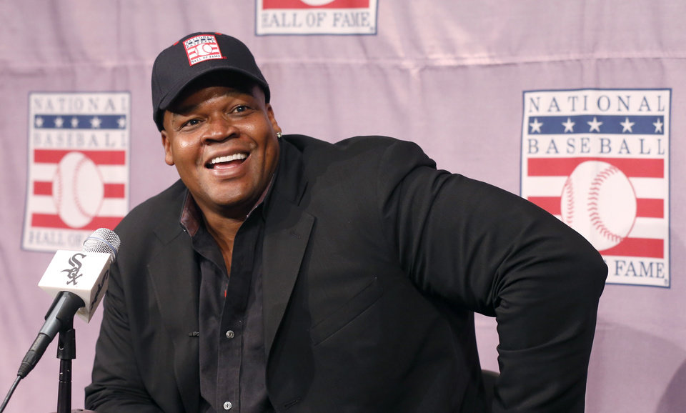 Photo - Chicago White Sox slugger Frank Thomas smiles as he listens to a question during a news conference about his selection into the MLB Baseball Hall Of Fame, Wednesday, Jan. 8, 2014, at U.S. Cellular Field in Chicago. Thomas joins Greg Maddux and Tom Glavine as first ballot inductees Wednesday, and will be inducted in Cooperstown on July 27 along with managers Bobby Cox, Joe Torre and Tony La Russa, elected last month by the expansion-era committee. (AP Photo/Charles Rex Arbogast)