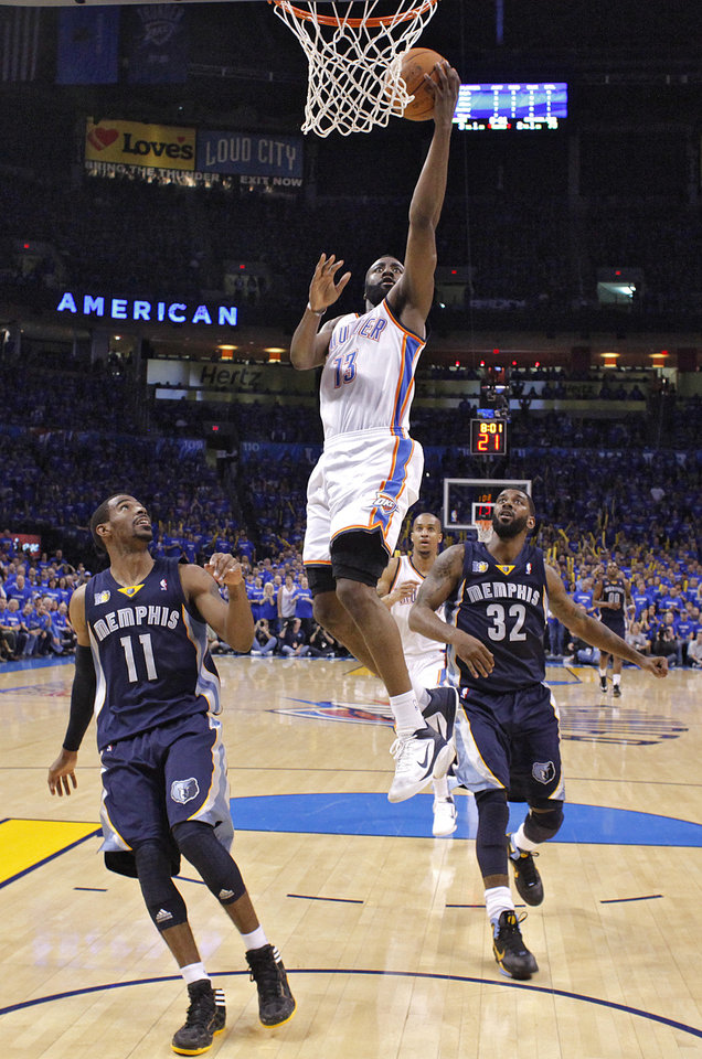 Photo - Oklahoma City's James Harden (13) drives to the basket past Mike Conley (11) of Memphis and O.J. Mayo (32) of Memphis during game two of the Western Conference semifinals between the Memphis Grizzlies and the Oklahoma City Thunder in the NBA basketball playoffs at Oklahoma City Arena in Oklahoma City, Tuesday, May 3, 2011. Photo by Chris Landsberger, The Oklahoman