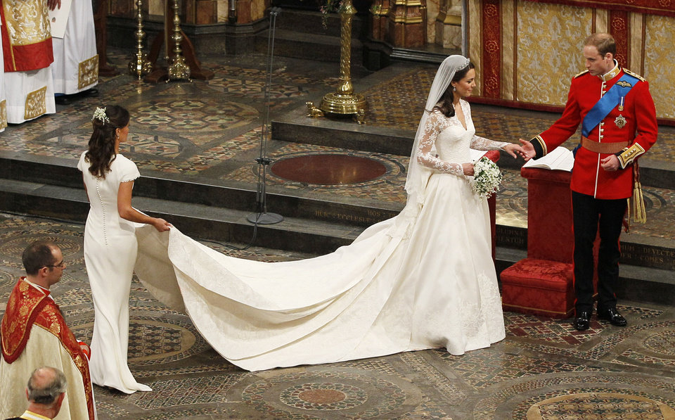 Photo - Britain's Prince William and his wife Kate, Duchess of Cambridge, accompanied by her maid of honour Pippa Middleton leave after wedding service in Westminster Abbey at the Royal Wedding in London Friday, April, 29, 2011. (AP Photo/Kirsty Wigglesworth, pool)  ORG XMIT: RWFO197