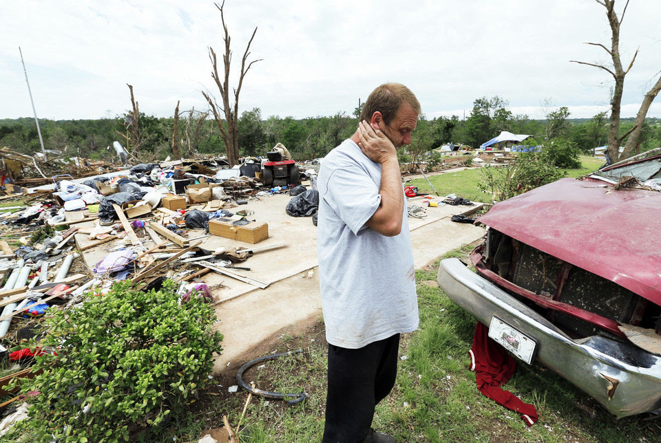 Terry DeSpain stands in front of the garage of his home which was obliterated by Sunday\'s tornado in the Woodlands and Pecan Valley area on Thursday, May 23, 2013 in Little Axe, Okla. Photo by Steve Sisney, The Oklahoman