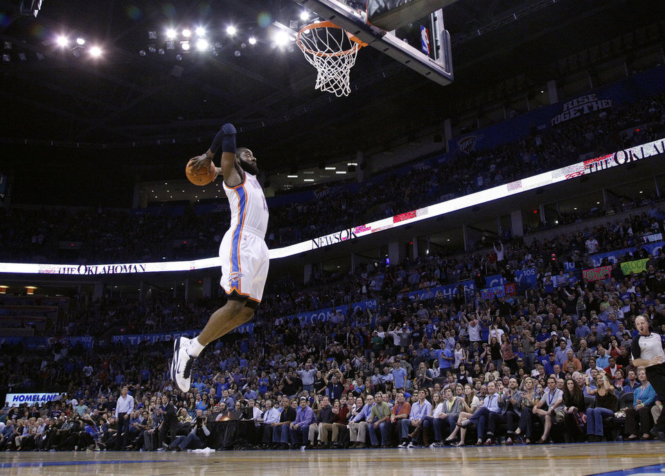 Photo - Oklahoma City's James Harden (13) dunks during the NBA basketball game between the Oklahoma City Thunder and the Los Angeles Lakers, Sunday, Feb. 27, 2011, at the Oklahoma City Arena. Photo by Sarah Phipps, The Oklahoman