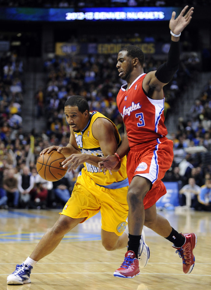 Photo - Denver Nuggets guard Andre Miller (24) drives past Los Angeles Clippers guard Chris Paul (3) during the third quarter of an NBA basketball game, Tuesday, Jan. 1, 2013, in Denver. (AP Photo/Jack Dempsey)