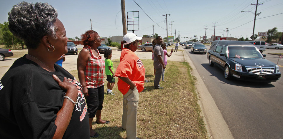 Photo - Clara Luper's funeral procession moves along Martin Luther King Avenue, Friday,  June 17, 2011.      Photo by David McDaniel, The Oklahoman
