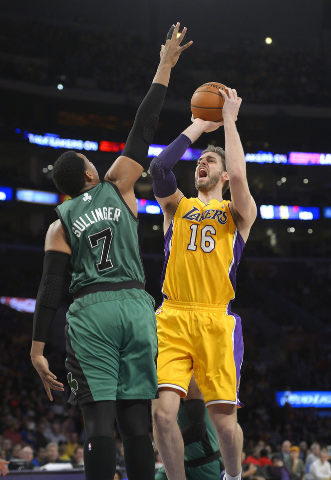 Photo - Los Angeles Lakers center Pau Gasol, right, puts up a shot as Boston Celtics center Jared Sullinger defends during the first half of an NBA basketball game, Friday, Feb. 21, 2014, in Los Angeles. (AP Photo/Mark J. Terrill)