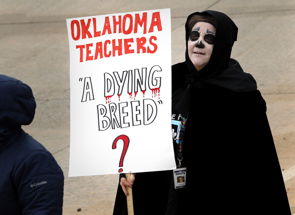 Photo - Jackson Elementary School teacher Amy Fillman heads to the State Capitol for a teacher's rally  on Monday, April 2, 2018 in Oklahoma City, Okla.  Photo by Steve Sisney, The Oklahoman