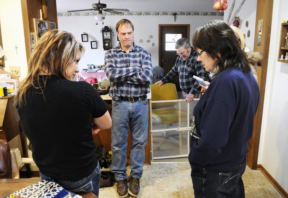 Cold Spring, Minn., Police Officer Tom Decker\'s sister Shelly, brother Eddie, father John and mother Rosella remember their brother and son in the kitchen of their family farm near Cold Spring Friday, Nov. 30, 2012. Decker was killed while on duty while doing a welfare check. (AP Photo/St. Cloud Times, Jason Wachter) NO SALES