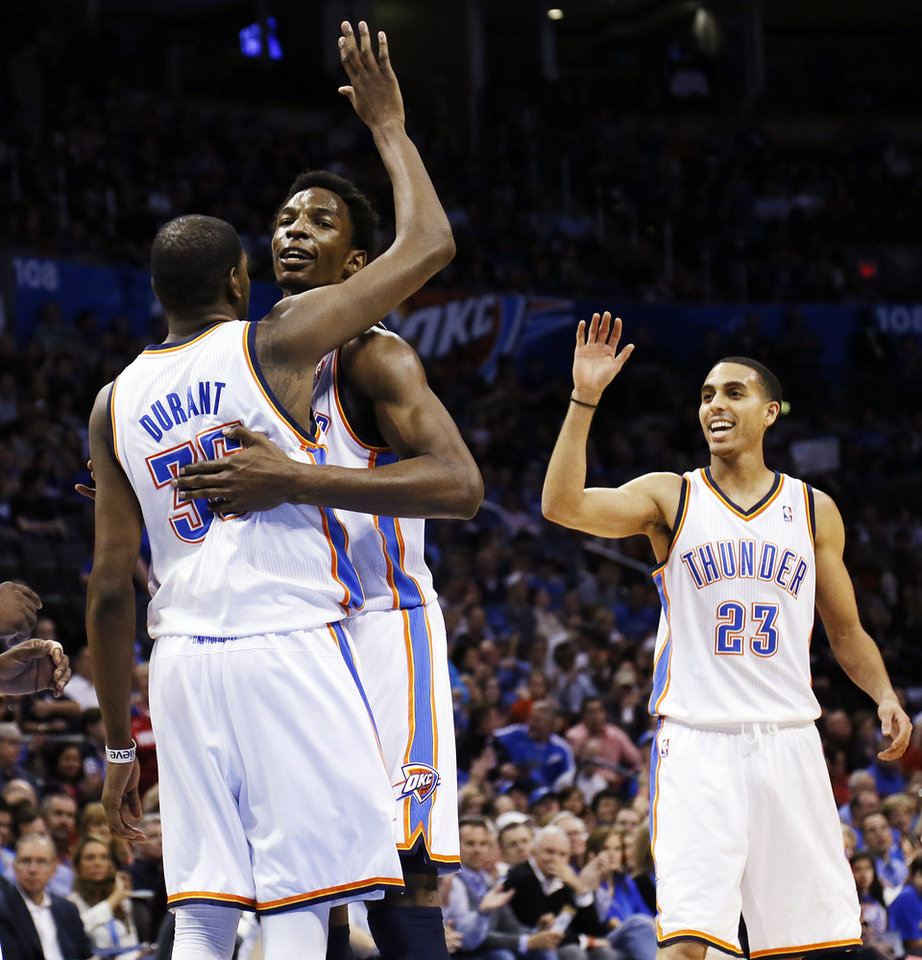 Oklahoma City\'s Kevin Durant (35), Hasheem Thabeet (34) and Kevin Martin (23) celebrate after Durant made a basket and was fouled during an NBA basketball game between the Oklahoma City Thunder and the Dallas Mavericks at Chesapeake Energy Arena in Oklahoma City, Monday, Feb. 4, 2013. Photo by Nate Billings, The Oklahoman