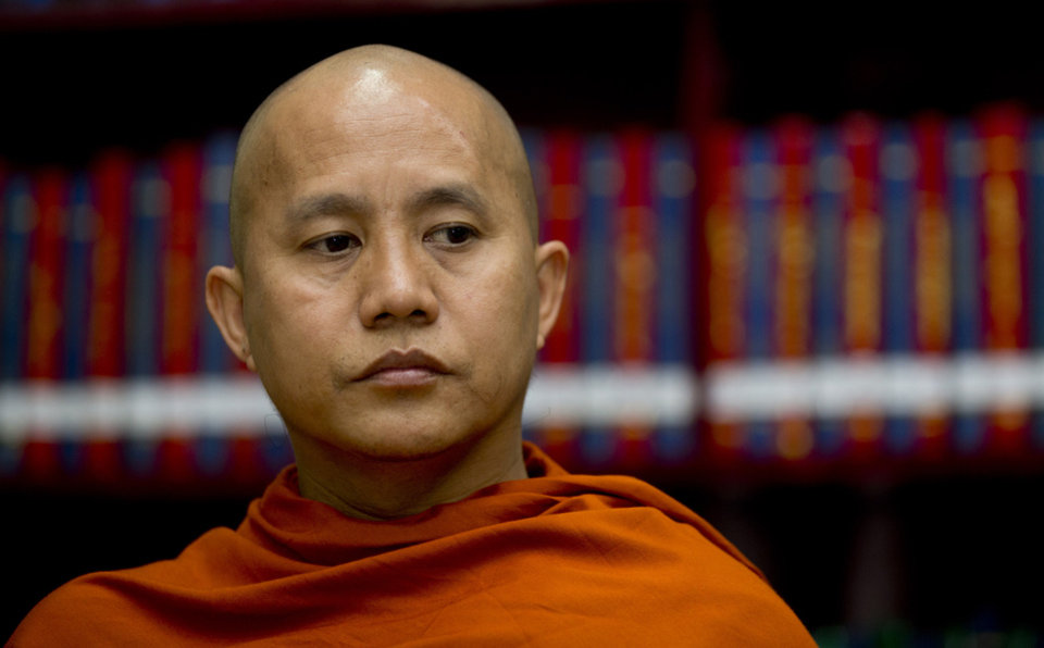 Photo - Buddhist monk Wirathu sits in the library of the Ma Soe Yein monastery during an interview in Mandalay, Myanmar on March 27, 2013. The popular monk insists he is a man of peace, but has emerged as the spiritual leader of a pro-Buddhist fringe movement accused of fueling a bloody campaign of sectarian violence. Wirathu insists the world has misunderstood him.