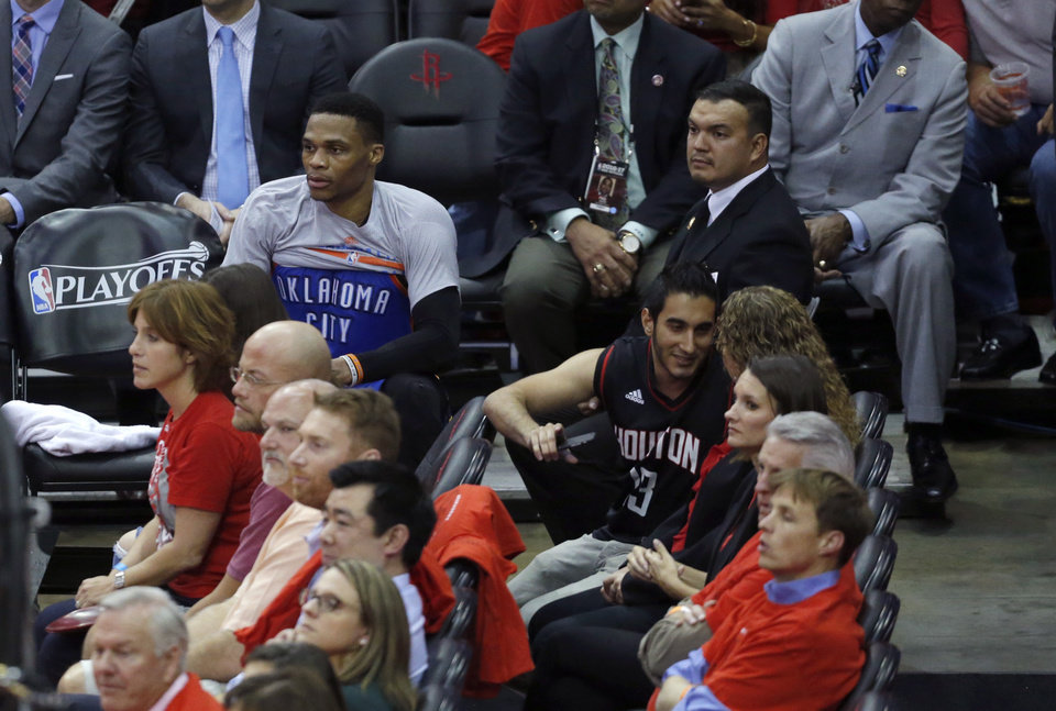 Photo - Oklahoma City's Russell Westbrook (0) sits on the bench in the fourth quarter during Game 5 in the first round of the NBA playoffs between the Oklahoma City Thunder and the Houston Rockets in Houston, Texas,  Tuesday, April 25, 2017.  Houston won 105-99. Photo by Sarah Phipps, The Oklahoman