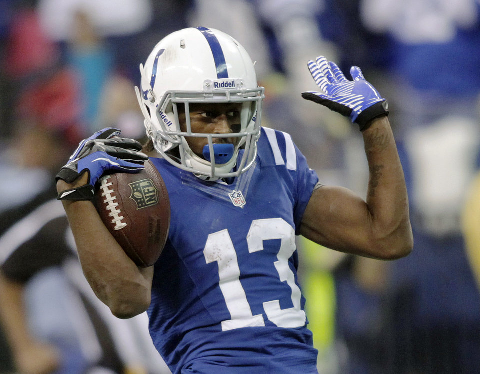 Indianapolis Colts' T.Y. Hilton (13) reacts following a 70-yard touchdown reception during the second half of an NFL football game against the Houston Texans, Sunday, Dec. 30, 2012, in Indianapolis. (AP Photo/AJ Mast)