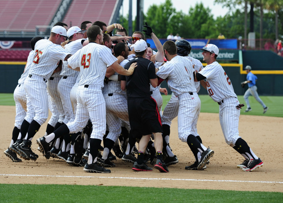 Photo - Maryland players celebrate their 4-3 win over Old Dominion during an NCAA college baseball regional tournament game in Columbia, S.C.,  Friday, May 30, 2014.  (AP Photo/ Richard Shiro)
