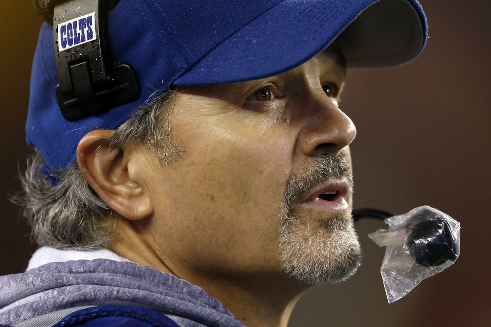 Photo - Indianapolis Colts head coach Chuck Pagano watches the action from the sidelines during the second half of an AFC divisional NFL playoff football game against the New England Patriots in Foxborough, Mass., Saturday, Jan. 11, 2014. (AP Photo/Michael Dwyer)