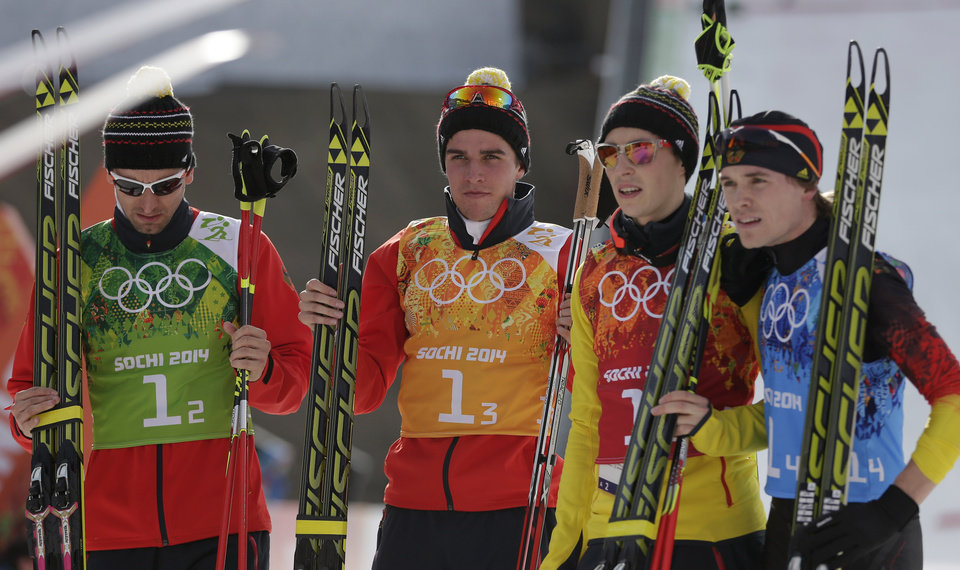 Photo - Germany's team Bjoern Kircheisen, Johannes Rydzek, Eric Frenzel, and Fabian Riessle, from left, pose for a photograph after winning the silver during the cross-country portion of the Nordic combined Gundersen large hill team competition at the 2014 Winter Olympics, Thursday, Feb. 20, 2014, in Krasnaya Polyana, Russia. (AP Photo/Matthias Schrader)