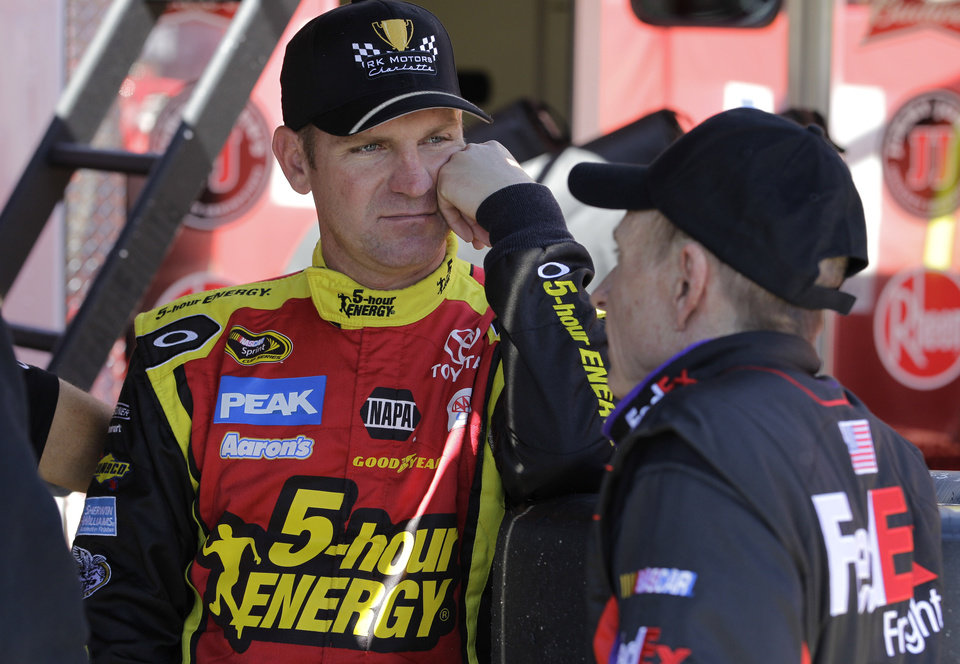 Photo - Driver Clint Bowyer, left, talks with Mark Martin, right, after practice for Sunday's NASCAR Sprint Cup series auto race at Martinsville Speedway in Martinsville, Va., Friday, April 5, 2013. (AP Photo/Steve Helber)