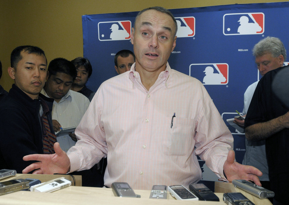 Photo - FILE - In this Nov. 16, 2010 file photo, Rob Manfred, Major League Baseball executive vice president for labor relations, talks to reporters during the meeting of baseball's general managers in Lake Buena Vista, Fla. Rob Manfred has been elected baseball's 10th commissioner, Thursday, Aug. 14, 2014 and will succeed Bud Selig in January. (AP Photo/Phelan M. Ebenhack, File)
