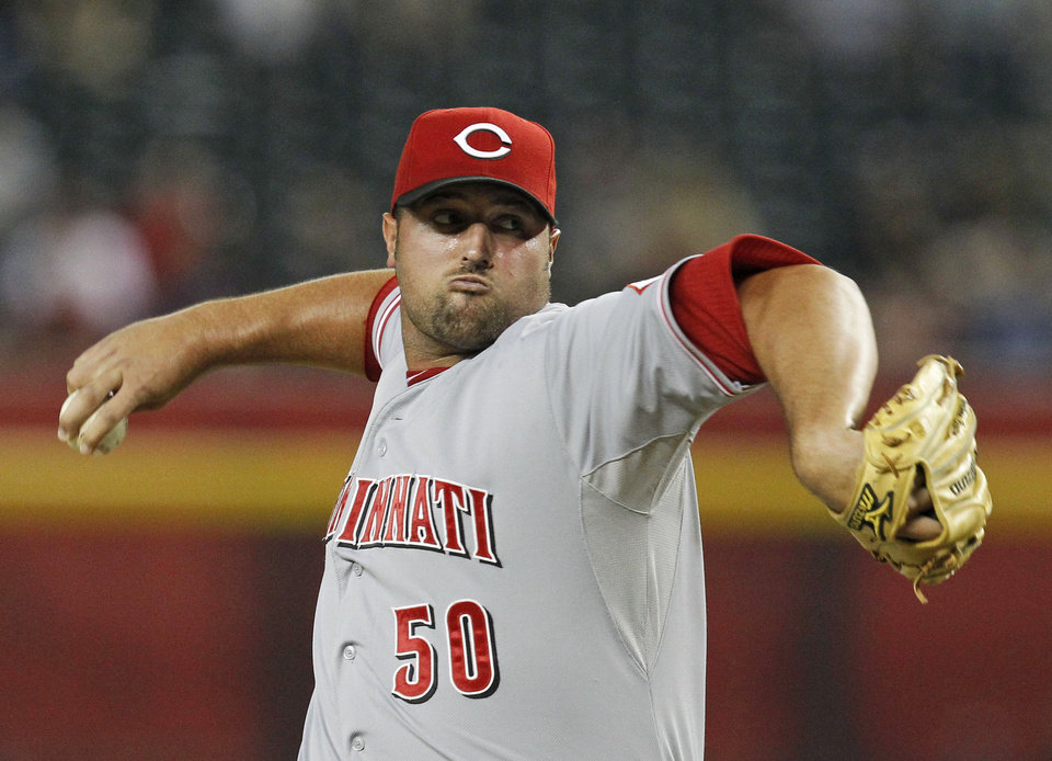 FILE - This Aug. 27, 2012 file photo shows Cincinnati Reds\' Jonathan Broxton throwing against the Arizona Diamondbacks during a baseball game in Phoenix. The Reds have signed Broxton to a three-year, $21 million contract, giving the NL Central champions a potential closer. (AP Photo/Ross D. Franklin, File)