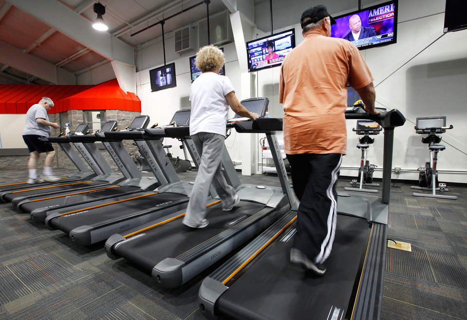 Photo - File photo: People exercise on treadmills at a YMCA location in Oklahoma City. [The Oklahoman archives]