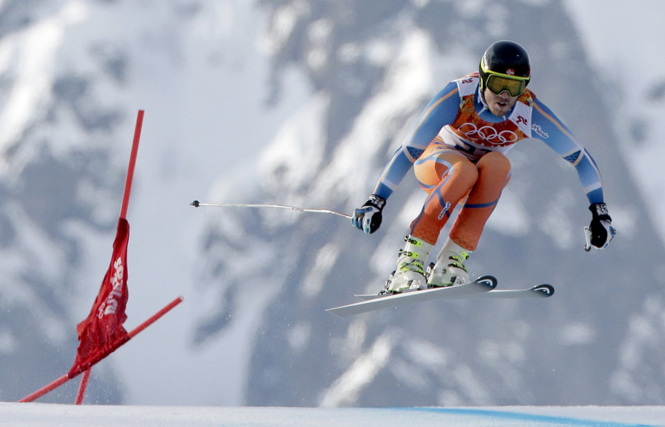 Photo - Gold medal winner Norway's Kjetil Jansrud makes a jump in the men's super-G at the Sochi 2014 Winter Olympics, Sunday, Feb. 16, 2014, in Krasnaya Polyana, Russia. (AP Photo/Charlie Riedel)