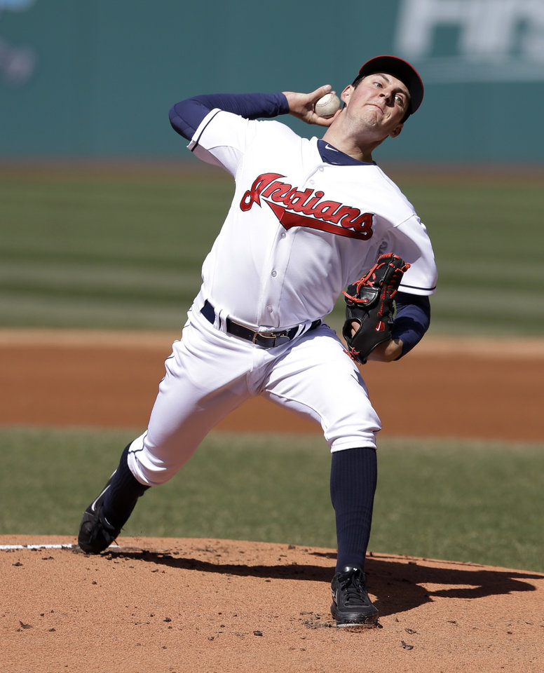 Photo - Cleveland Indians starting pitcher Trevor Bauer delivers in the first inning in the second game of a baseball doubleheader against the San Diego Padres, Wednesday, April 9, 2014, in Cleveland. (AP Photo/Tony Dejak)