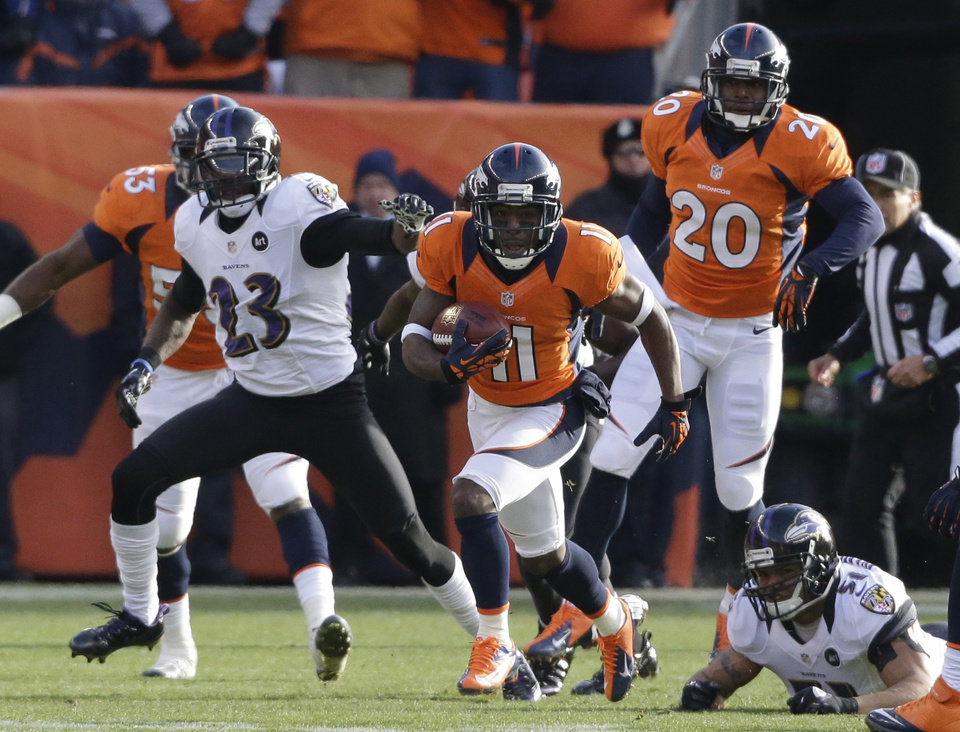 Photo - Denver Broncos wide receiver Trindon Holliday (11) returns a punt 90 yards for a touchdown against the Baltimore Ravens in the first quarter of an AFC divisional playoff NFL football game, Saturday, Jan. 12, 2013, in Denver. (AP Photo/Ed Andrieski)