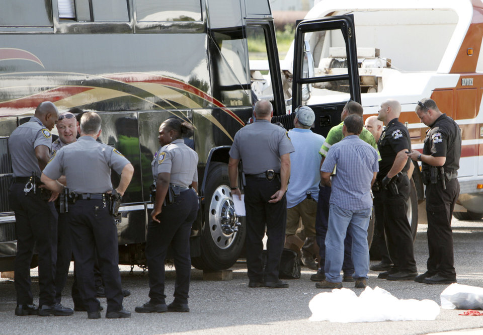 Photo - Oklahoma City police and Oklahoma County sheriff's department investigators use a search warrant to search the 2 Chainz tour bus at the police training center in Oklahoma City, OK, Thursday, August 22, 2013.  Photo by Paul Hellstern, The Oklahoman  PAUL HELLSTERN - Oklahoman