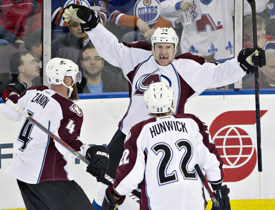 Photo - Colorado Avalanche's Greg Zanon, Cody McLeod and Matt Hunwick celebrate McLeod's goal against the Edmonton Oilers during the first period of an NHL hockey game in Edmonton, Alberta, on Saturday Feb. 16, 2013. (AP Photo/The Canadian Press, Jason Franson)