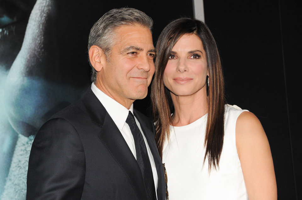 "Photo - Actors George Clooney and Sandra Bullock attend the premiere of ""Gravity"" at the AMC Lincoln Square Theaters on Tuesday, Oct. 1, 2013, in New York. (Photo by Evan Agostini/Invision/AP) ORG XMIT: NYEA113"