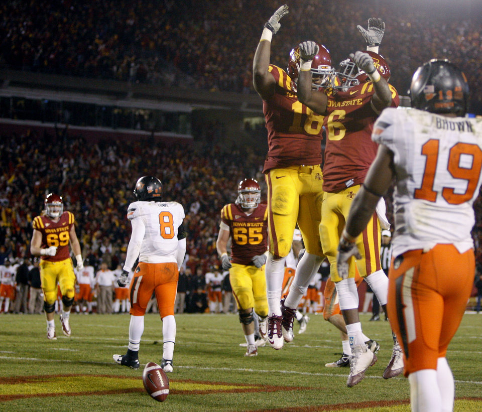 Photo - Iowa State's Albert Gary (18) and Darius Darks (6) celebrate after a touchdown in the fourth quarter during a college football game between the Oklahoma State University Cowboys (OSU) and the Iowa State University Cyclones (ISU) at Jack Trice Stadium in Ames, Iowa, Friday, Nov. 18, 2011. Photo by Bryan Terry, The Oklahoman