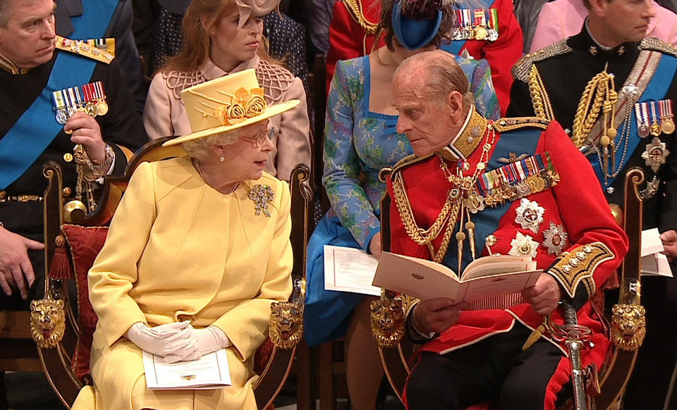Photo - In this image taken from video, Britain's Queen Elizabeth II, left, speaks with Britain's Prince Philip at Westminster Abbey for the Royal Wedding in London on Friday, April, 29, 2011. (AP Photo/APTN) EDITORIAL USE ONLY NO ARCHIVE PHOTO TO BE USED SOLELY TO ILLUSTRATE NEWS REPORTING OR COMMENTARY ON THE FACTS OR EVENTS DEPICTED IN THIS IMAGE ORG XMIT: RWVM196