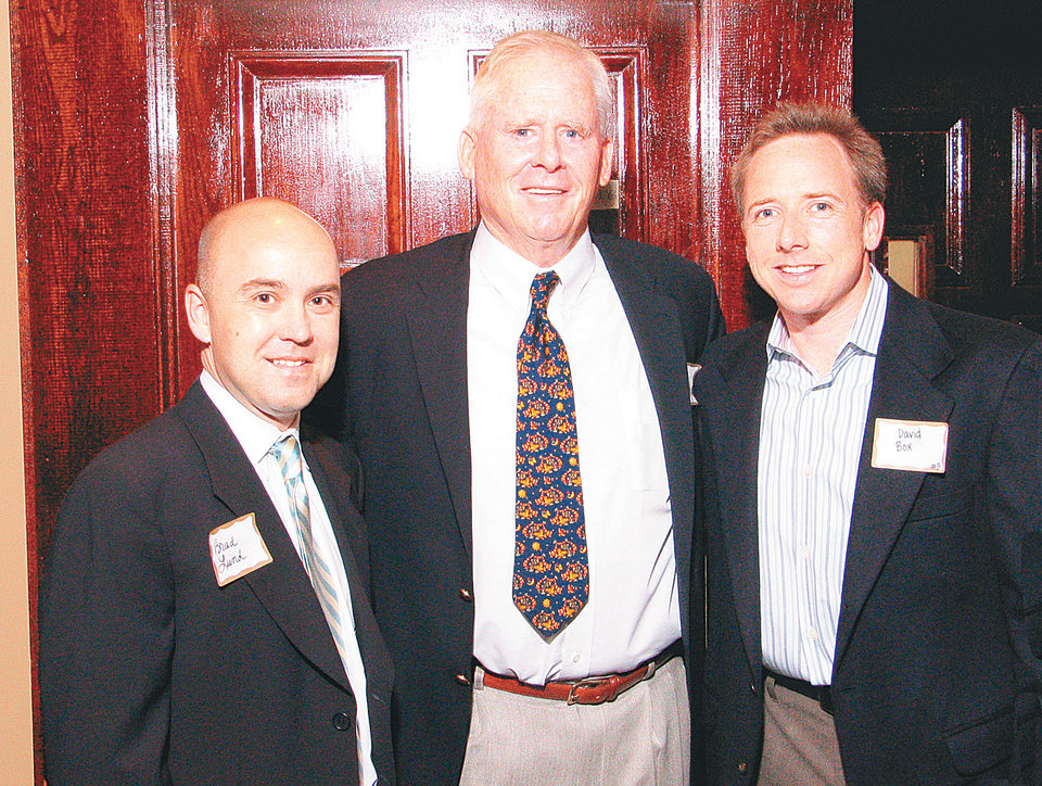 Photo - Brad Lund, speaker Dennis Ralston and David Box visit at a dinner at the Greens Golf and Country Club. With the theme