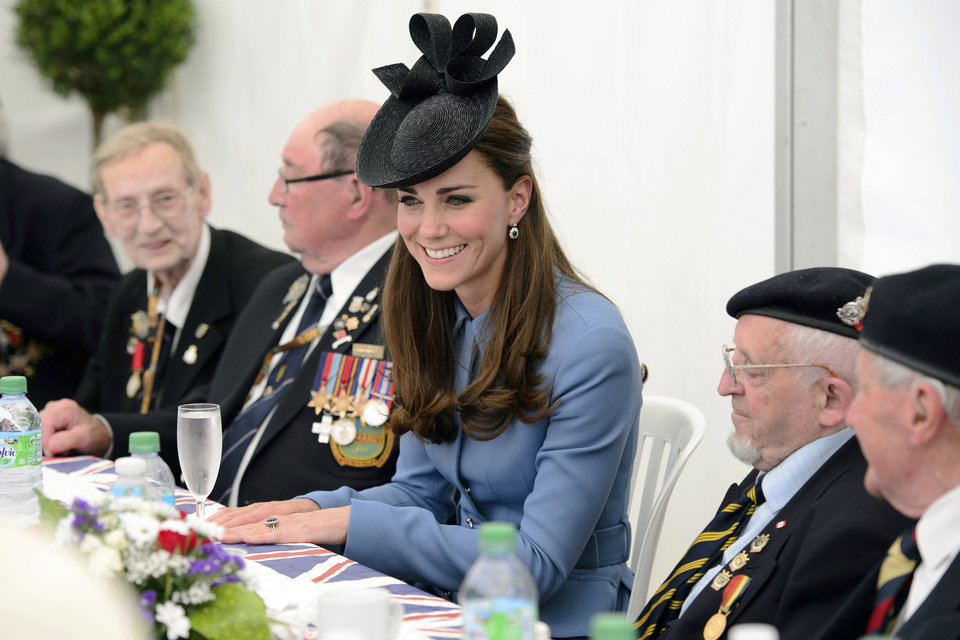 Photo - Princess Catherine, Duchess of Cambridge, speaks to World War II veterans in Arromanches-les-Bains, Normandy, France, Friday, June 6, 2014, during an event commemorating the 70th anniversary of the World War II Allied landings in Normandy. World leaders and veterans gathered by the beaches of Normandy on Friday to mark the 70th anniversary of World War Two's D-Day landings. (AP Photo/Leon Neal, Pool)