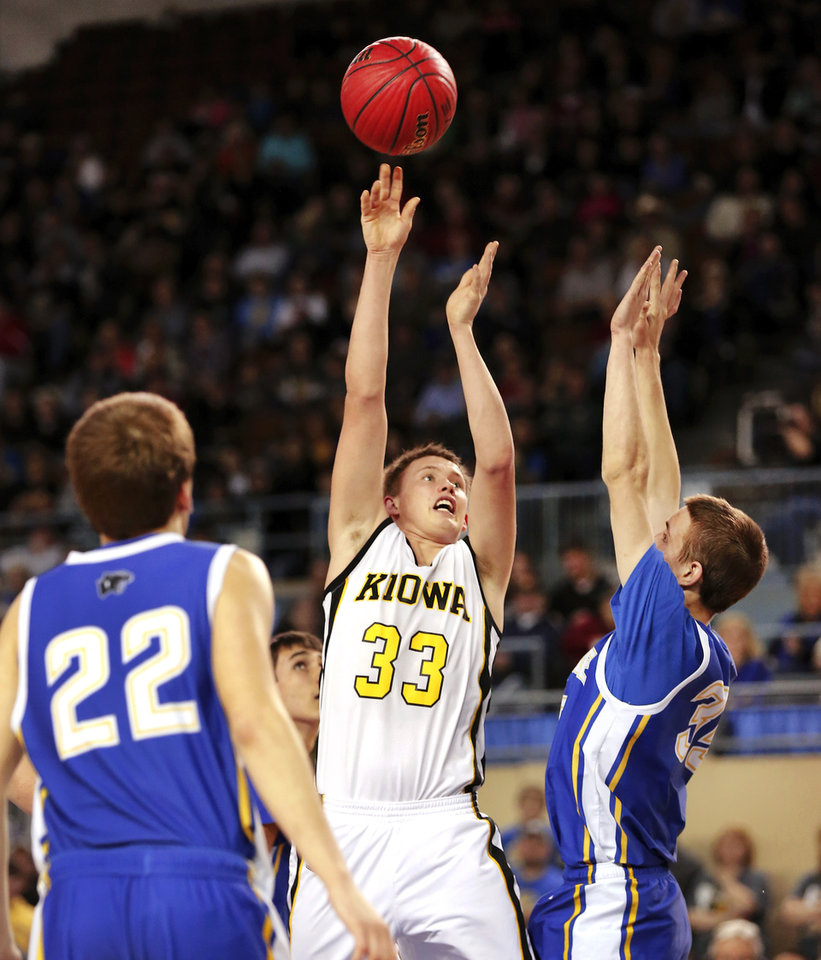 Photo - Kiowa's Bryce Overton release a shot over a Glencoe defender during Class A boys high school basketball championship game in the Jim Norick Arena at State Fair Park on  Saturday, March 8, 2014. Glencoe defeated Kiowa, 57-39. Photo by Jim Beckel, The Oklahoman