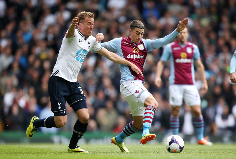Photo - Tottenham Hotspur's Harry Kane, left, and Aston Villa's Matthew Lowton during the English Premier League soccer match at White Hart Lane, London, Sunday May 11, 2014. (AP Photo/PA, John Walton) UNITED KINGDOM OUT  NO SALES  NO ARCHIVE