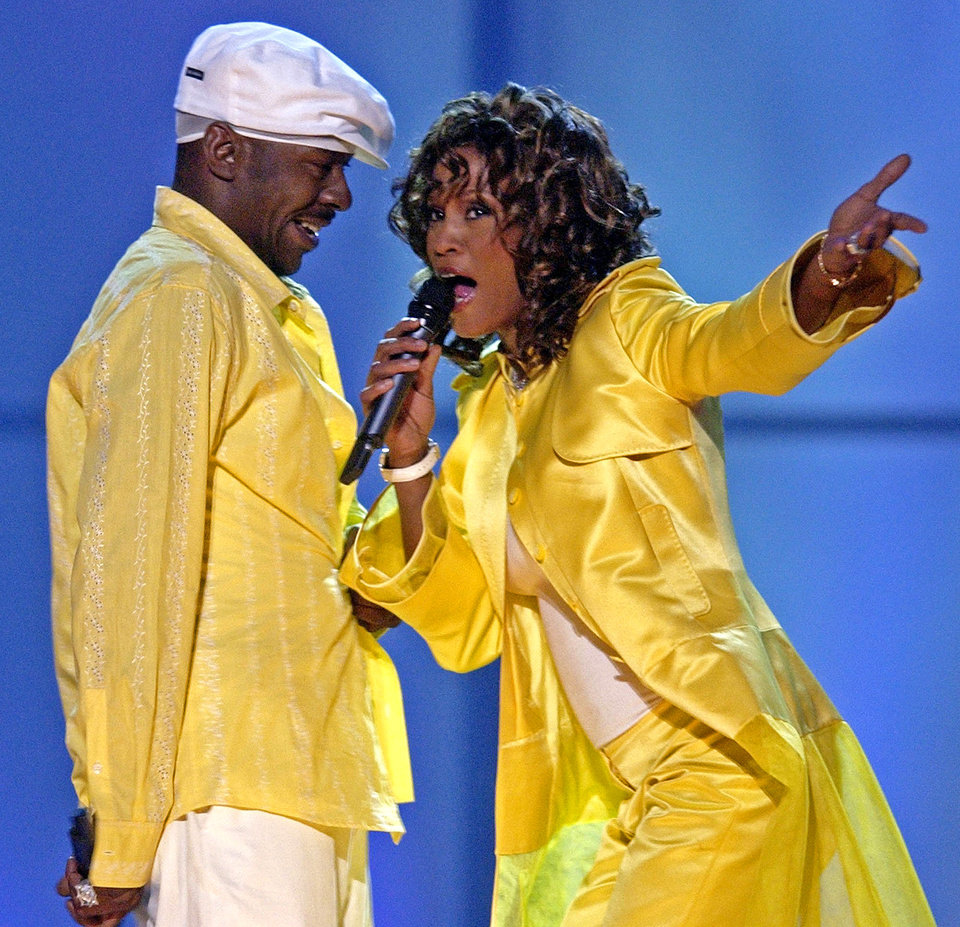 "FILE - In this May 23, 2003 file photo, Whitney Houston, right, and her husband, Bobby Brown, perform during the ""VH1 Divas"" duets show in Las Vegas. Whitney Houston, who reigned as pop music's queen until her majestic voice and regal image were ravaged by drug use, has died, Saturday, Feb. 11, 2012. She was 48. (AP Photo/Joe Cavaretta, File) ORG XMIT: NY126"