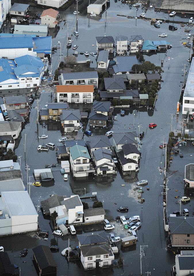 Photo - Oarai town is submerged after a tsunami in Ibaraki prefecture (state), Japan, Friday, March 11, 2011. The tsunami spawned by the largest earthquake in Japan's recorded history slammed the eastern coast Friday, sweeping away boats, cars, homes and people. (AP Photo/Kyodo News) JAPAN OUT, MANDATORY CREDIT, FOR COMMERCIAL USE ONLY IN NORTH AMERICA ORG XMIT: TTX810