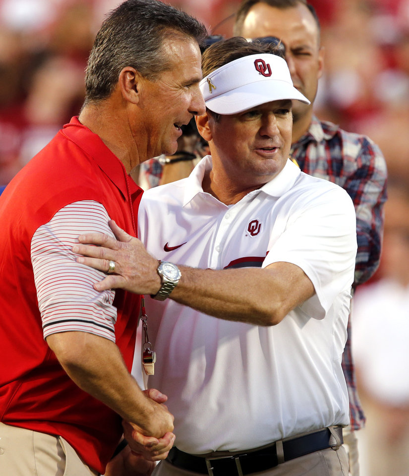 Photo - Ohio State head coach Urban Meyer and Oklahoma head coach Bob Stoops greet before a college football game between the University of Oklahoma Sooners (OU) and the Ohio State Buckeyes at Gaylord Family-Oklahoma Memorial Stadium in Norman, Okla., on Saturday, Sept. 17, 2016. Photo by Steve Sisney, The Oklahoman