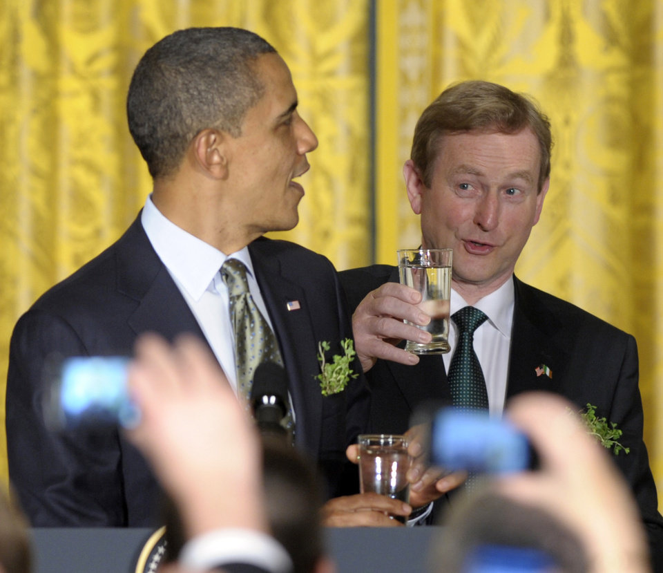 Photo -   FILE - In this March 20, 2012, file photo President Barack Obama and Irish Prime Minister Enda Kenny prepare for a toast during a St. Patrick's Day reception in the East Room of the White House in Washington. During the reception Enda presented Obama with a certificate of Irish heritage.